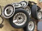 4 matching Ford rims - 1 spare; hubcaps