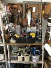 Wall lot of tools: hand saws, wrenches, screw drivers, hammers, cutting tools, etc.