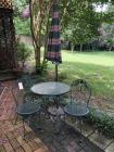 Iron glass top table w/ 2 chairs and umbrella stand