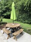 Round picnic table w/ 4 benches and umbrella