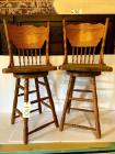 Pair of oak pressed-back barstools (swivel)