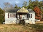 1801 Tipton Station Road Knoxville,  TN 37922. This 3 bedroom 2 bath home in south Knoxville has approx 1000+ square feet of heated space, central heating and air, located close to South Doyle High School and Bonnie Kate Elementary School. Home has a good