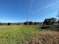 1.40 acres on East Lamar Alexander Parkway, Maryville, Tennessee 37804. Beautiful building lot with commercial potential! This lot has approximately (219 +or-) feet of frontage on East Lamar Alexander Parkway, and is currently zoned Suburbanizing in Bloun
