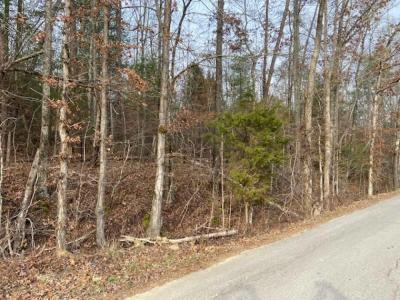 Tract 1: 5.23 surveyed acres with frontage on Ballplay Road. This beautiful tract has a good building site on the acreage and contains the old barn (AS-IS). It's not too far from Tellico lake, mostly wooded and gently rolling with several hundred feet of