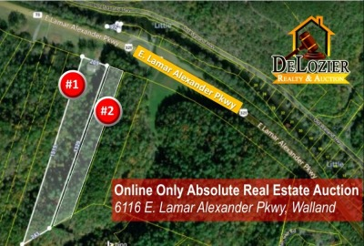 This lot features approximately 4.02 acres and 140 feet of frontage on East Lamar Alexander Parkway and and has good building sites on it. It is mostly wooded and gently slopes up at the road and slopes more as you go up about 1300 feet. Property has a wo