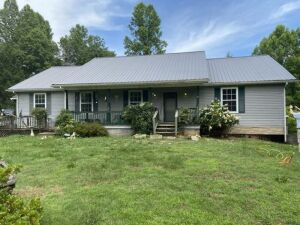 2427 Disney Lane Maryville, TN 37803 2427 Disney Lane Maryville, TN 37803 Just off Indian Warpath road, A spacious ranch  home built in 2000 w/ metal roof and vinyl siding. Home is approx. 1920 square feet on the main w/ a full basement partially finished