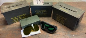 3 ammo cans and military issued goggles