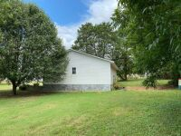 basement ranch on 2.68 acres of very nice land and has a finished living area in the basement (click for more details) - 12