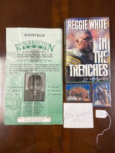 """In the Trenches"" Reggie White autobiography, Reggie White autograph, ""Resurrection 1990"" Reggie White poster w/ autograph, two Big Orange UT cards, Neyland stadium & Reggie White"