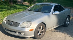 2001 Mercedes SLK320 - 6-speed stick shift - 105,648 miles - garage kept (2 owner vehicle) - runs and drives well, has title! Some hail damage. (Good looking car!)