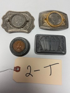 2 silver dollar belt buckles (Ike Bicentennial, 1972), British coin in lead casing, 1 other belt buckle