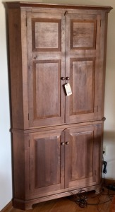 Antique style Walnut corner cupboard w/ beveled panel doors - contents NOT included