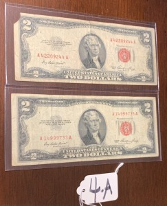 2 red seal 2 dollar bills 1953 series - small corner missing on one