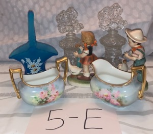 Two vintage perfume bottles, signed westmore baskets, two hummel type figures, lamoge cream and sugar
