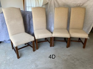 4 upholstered high-back chairs with tack detail.
