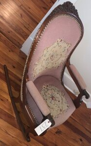 Rosewood rocker Upholstered with original cross stitch/needle point. Victorian Lincoln style.