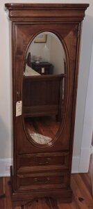 Henry Link bachelor's chiffarobe with door to drawers and beveled mirror
