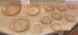 11 pink depression glass plates and saucers