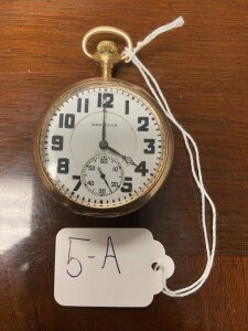 Hamilton pocket watch gold colored case, seems to be working.