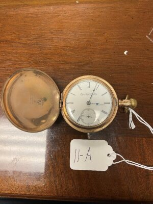 Elgin pocket watch, gold colored case, seems to be working