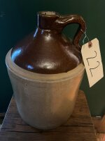 "2 gallon crock jug, ""E"" mark, small nick on base"