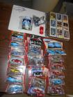 racing cards in autographed notebook, 20 die cast cars from the movie CARS