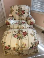 Floral upholstered arm chair with matching ottoman, Baker Furniture Co.